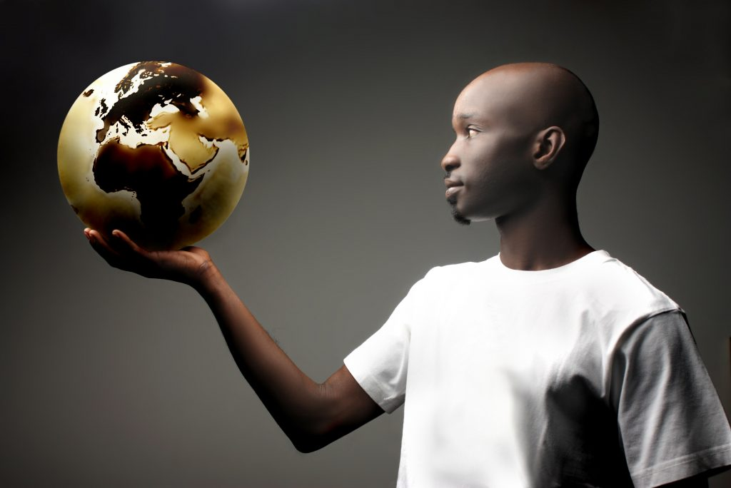Man holding world in his hand. Technology is making our world smaller but the barriers to effective communication from language challenges are ever present.